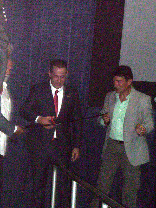 Miami Beach Mayor Philip Levine cutting 2014 Cinema Italy opening ribbon<br />
